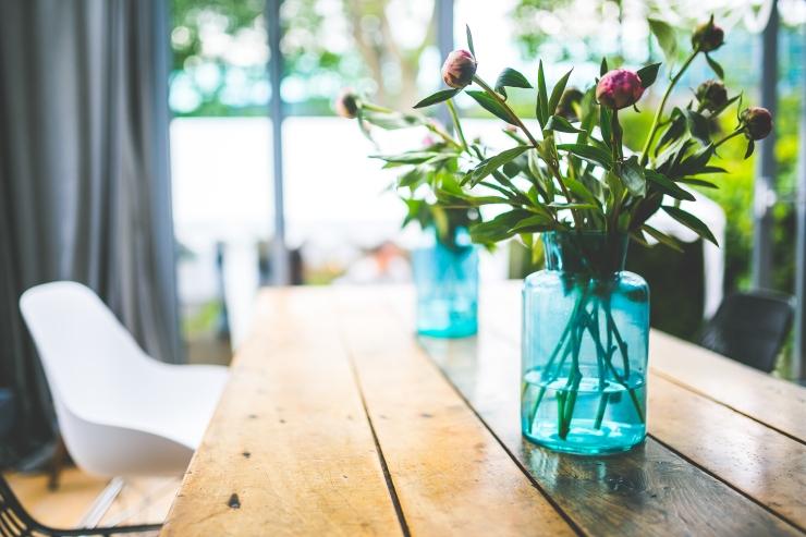 kaboompics.com_Peonies in a glass blue jar.jpg